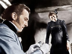THE CURSE OF FRANKENSTEIN, from left: Peter Cushing, Christopher Lee, 1957