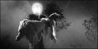 An electrified Lon Chaney Jr. carries an unconscious Anne Nagel in Man Made Monster