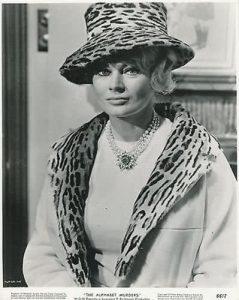 Anita Ekberg appears as Amanda Beatrice Cross