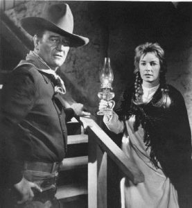"John Wayne, competing with Jimmy Stewart for the love of Vera Miles in ""The Man Who Shot Liberty Valance"""