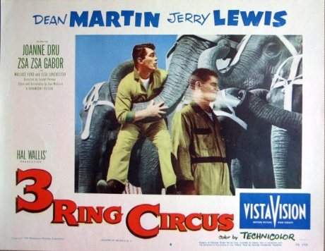Dean Martin and Jerry Lewis watering the elephants in 3 ring Circus