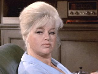 "Diana Dors as the sheepish wife in ""From Beyond the Grave"""