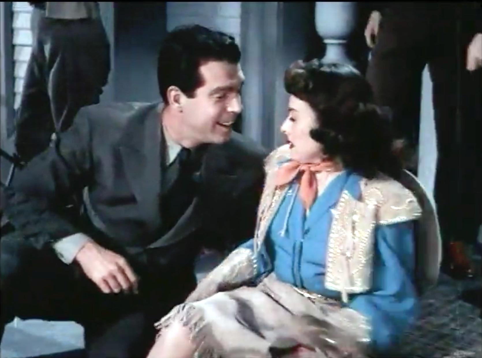 Celia Huston (Paulette Goddard) falls for Don Stuart (Fred MacMurray) literally, at the parade