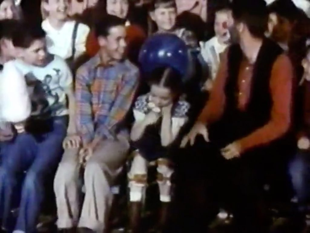 Jericho (Jerry Lewis) at the orphan's benefit, desperately trying to get a crippled little girl to laugh