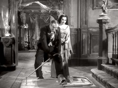 Come Back, Little Googie - Grandpa (Al Lewis) and Lily (Yvonne De Carlo) setting out a mousetrap.  A BIG mousetrap