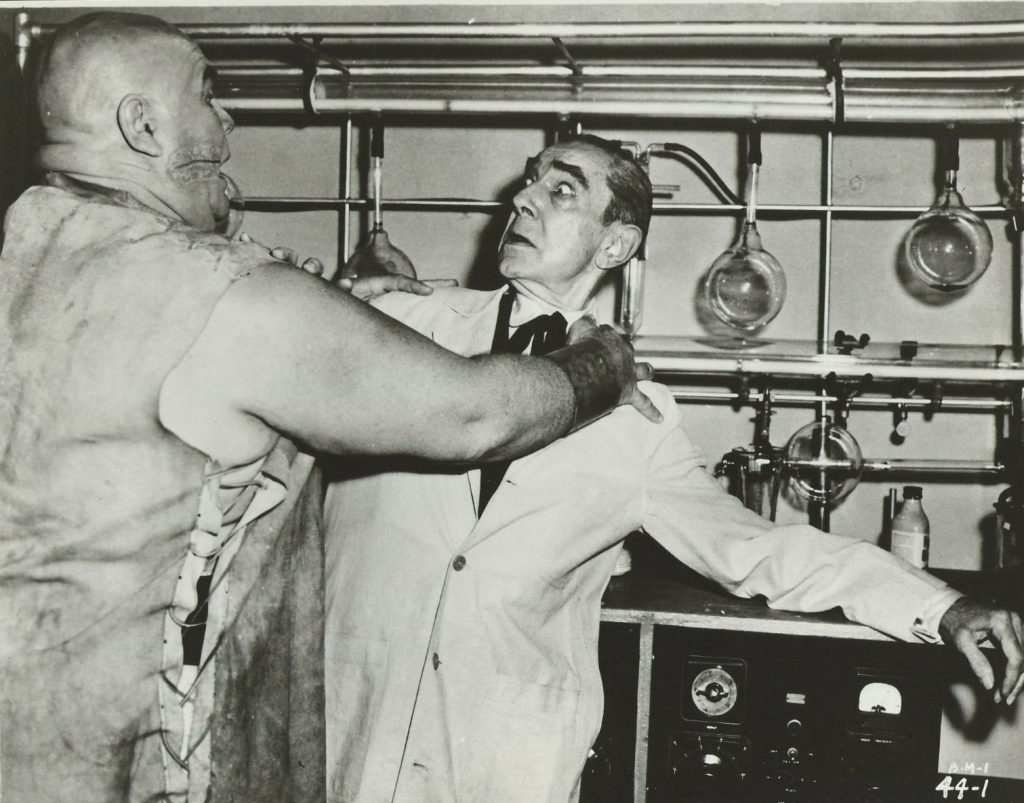 Lobo (Tor Johnson) attacks the mad scientist Dr. Vornoff (Bela Lugosi) in Bride of the Monster